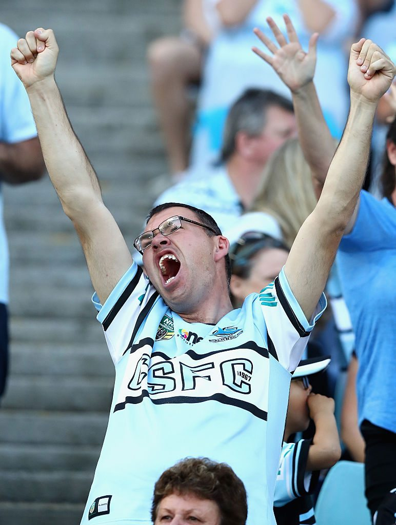 SYDNEY, AUSTRALIA - OCTOBER 02: Sharks fans cheer during the 2016 NRL Grand Final match between the Cronulla Sutherland Sharks and the Melbourne Storm at ANZ Stadium on October 2, 2016 in Sydney, Australia. (Photo by Ryan Pierse/Getty Images)